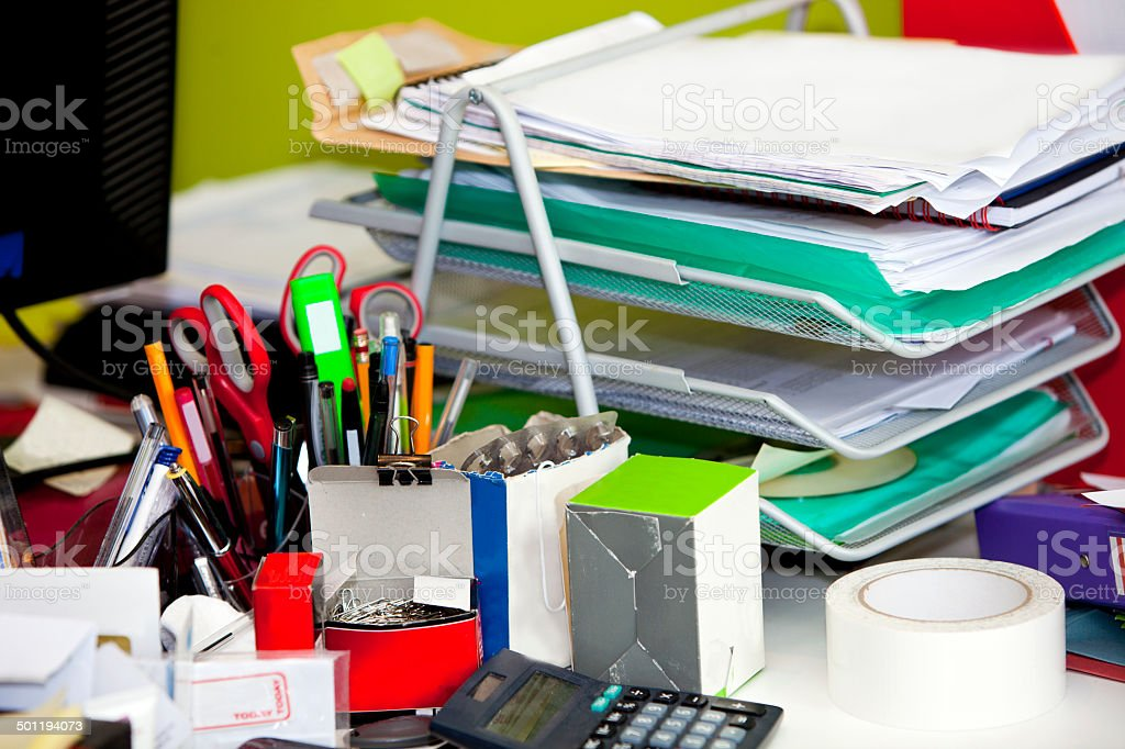 Close-up of real life messy desk in  office royalty-free stock photo