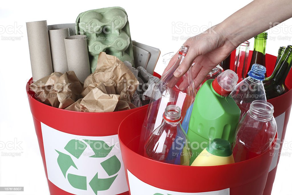 A close-up of recycling bins full of recyclable items stock photo