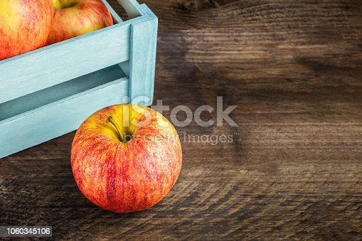 1020586746istockphoto Closeup of red and yellow apple with copyspace 1060345106