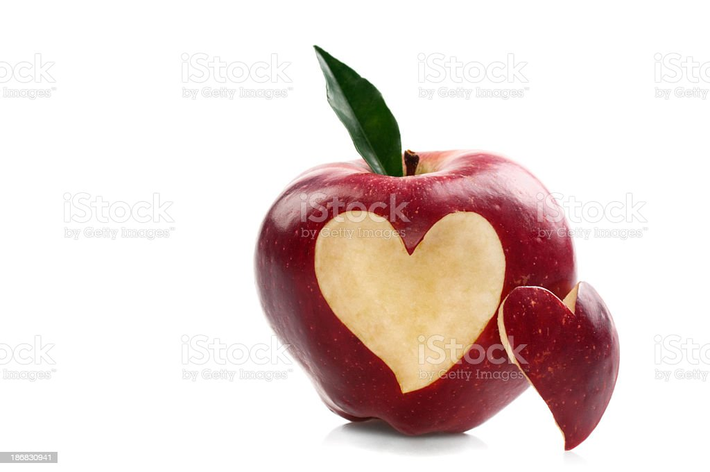 Close-up of red apple with heart-shaped cut stock photo