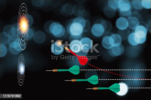 Closeup of Red arrow dart change direction to hit big target board among green arrow darts shooting to small target board . It is symbol of business investment competition to achieve goal and target.