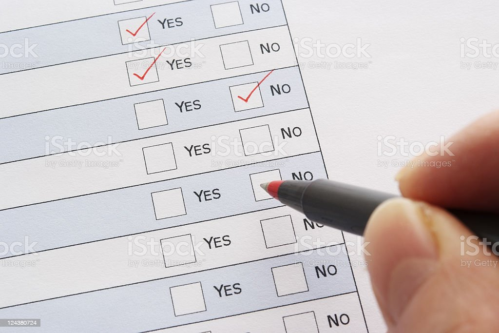 Close-up of red ball point pen marking a checkbox royalty-free stock photo