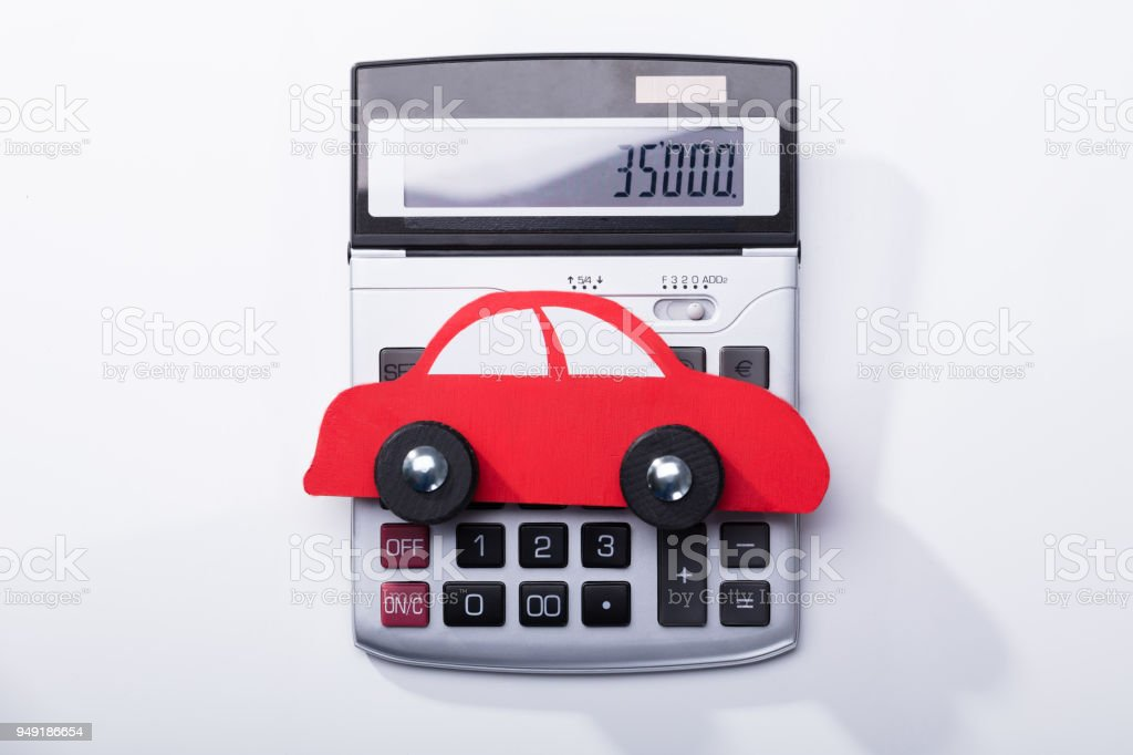 Close-up Of Red Car And Calculator stock photo