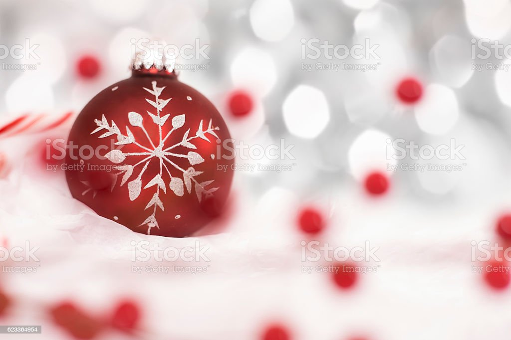 Closeup Of Red Christmas Ornament On White With Lights Stock