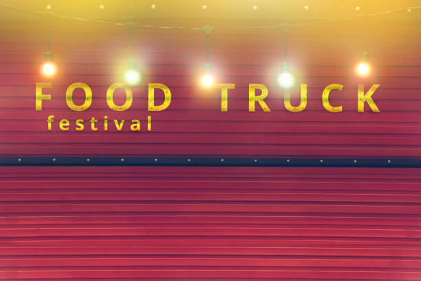 close-up of red food truck with colour light bulb, food festival background, no people stock photo