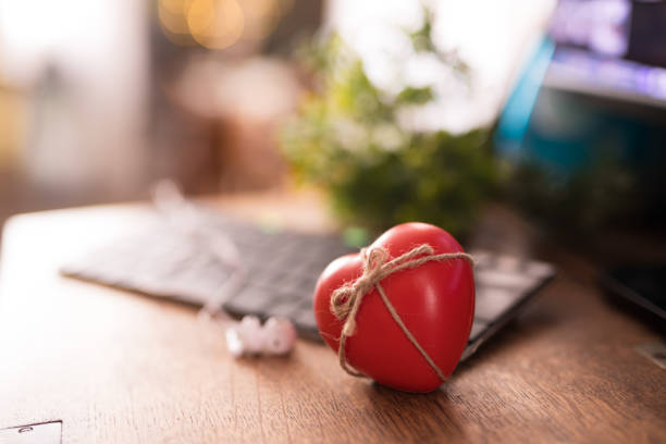 Closeup of red heart on table stock photo