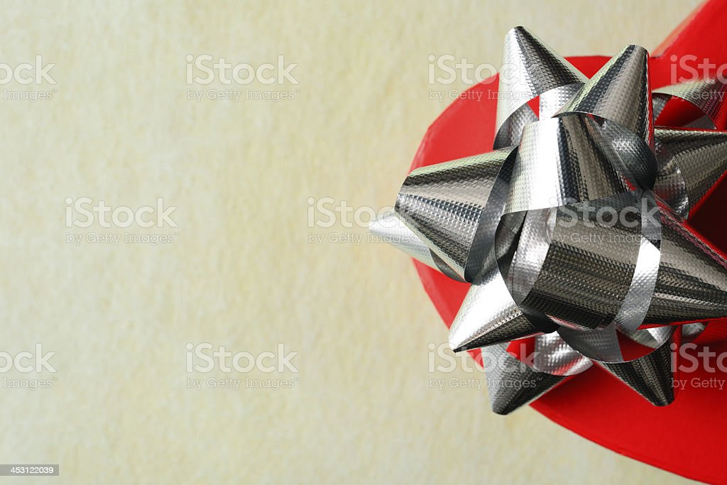 Close-up of red heart shape gift box with silver ribbon royalty-free stock photo