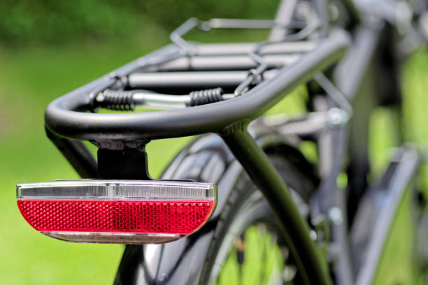 Close-up of red reflector back on a bicycle stock photo