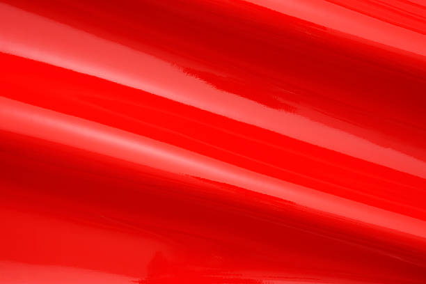 Close-up of red shiny vinyl wave texture background stock photo