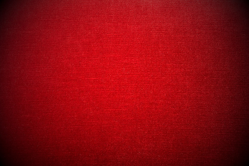 Close-up of red velvet sofa - vignetting effect