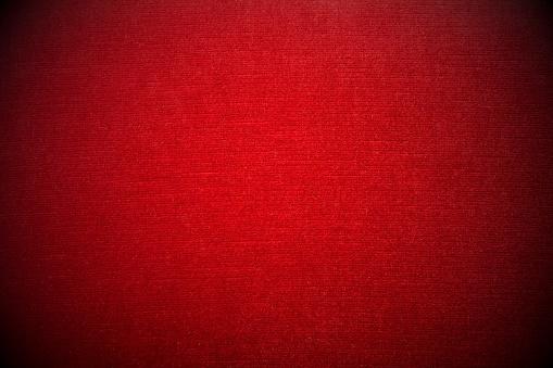 Close-up of red velvet sofa - vignetting effect - background