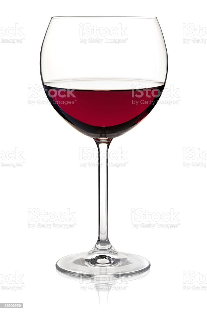 Close-up of red wine served in crystal clear glass stock photo