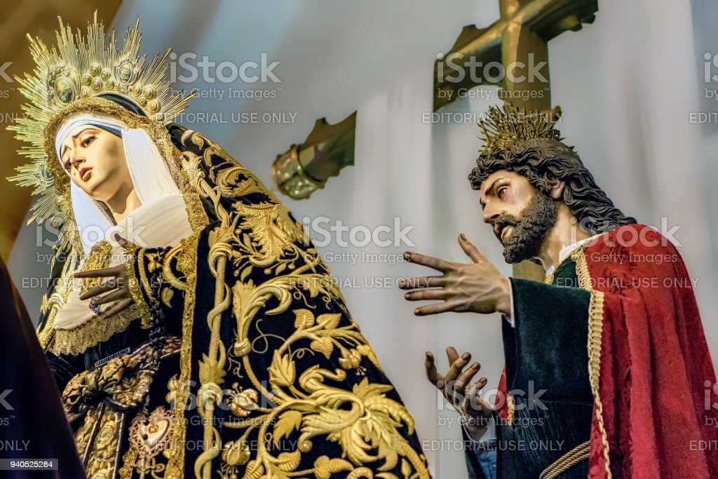 Closeup of religion sculptures taking part in Holy Week procession in Huelva, Spain. stock photo