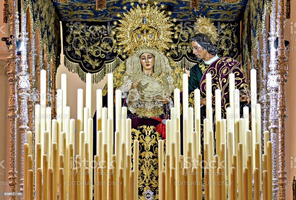 Closeup of religious float that is carried by devotees during Holy Week festivities in Huelva, Spain. stock photo