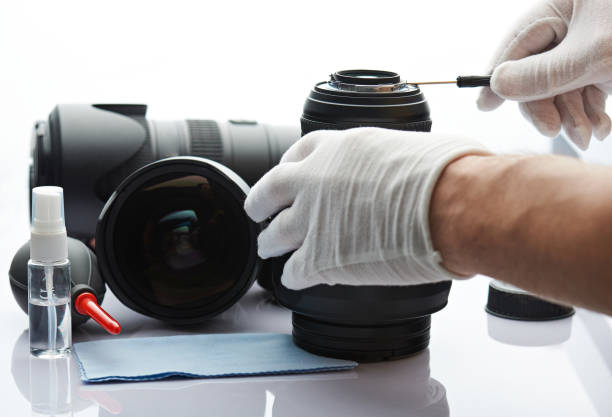 Closeup of repairing photography lens stock photo