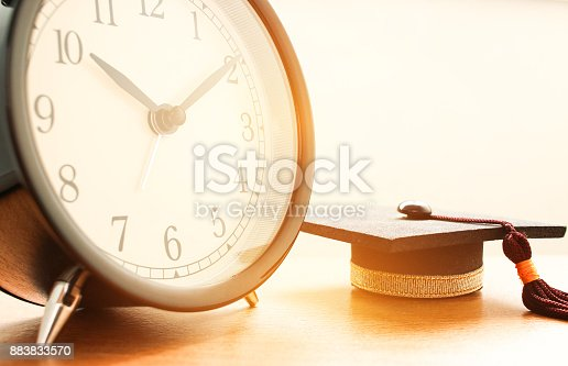 959387240 istock photo Closeup of Retro alarm clock with twelve o'clock. Time is indefinite continued progress of existence, events that occur in apparently irreversible succession from past through present in to the future 883833570