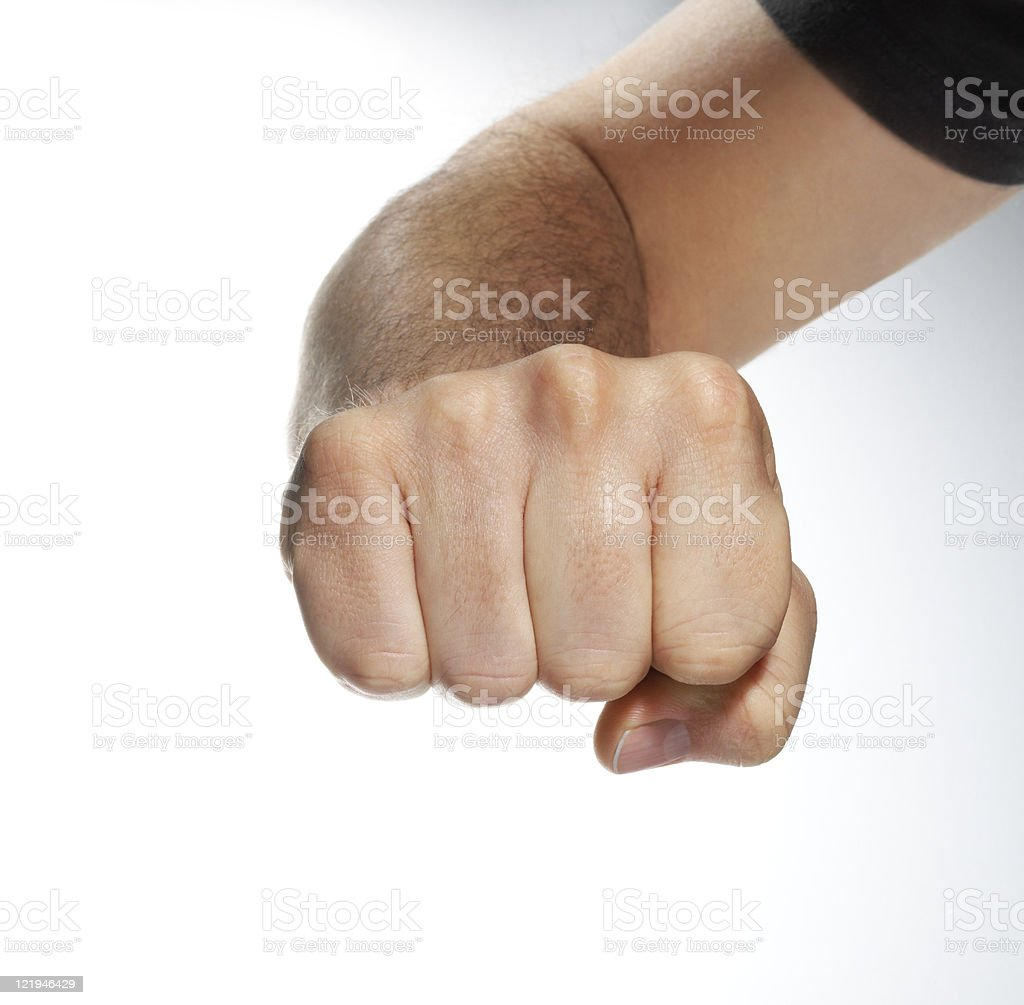 Closeup of right male hand raised up clenched fist royalty-free stock photo