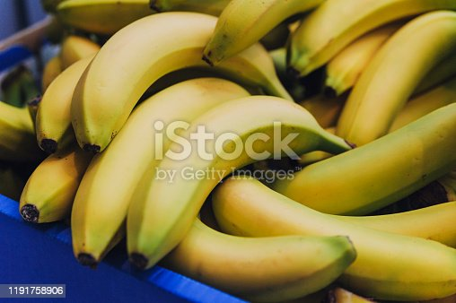Close-up of ripe bananas in box.