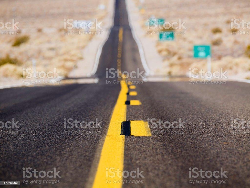 Closeup of road asphalt on Death Valley Highway stock photo