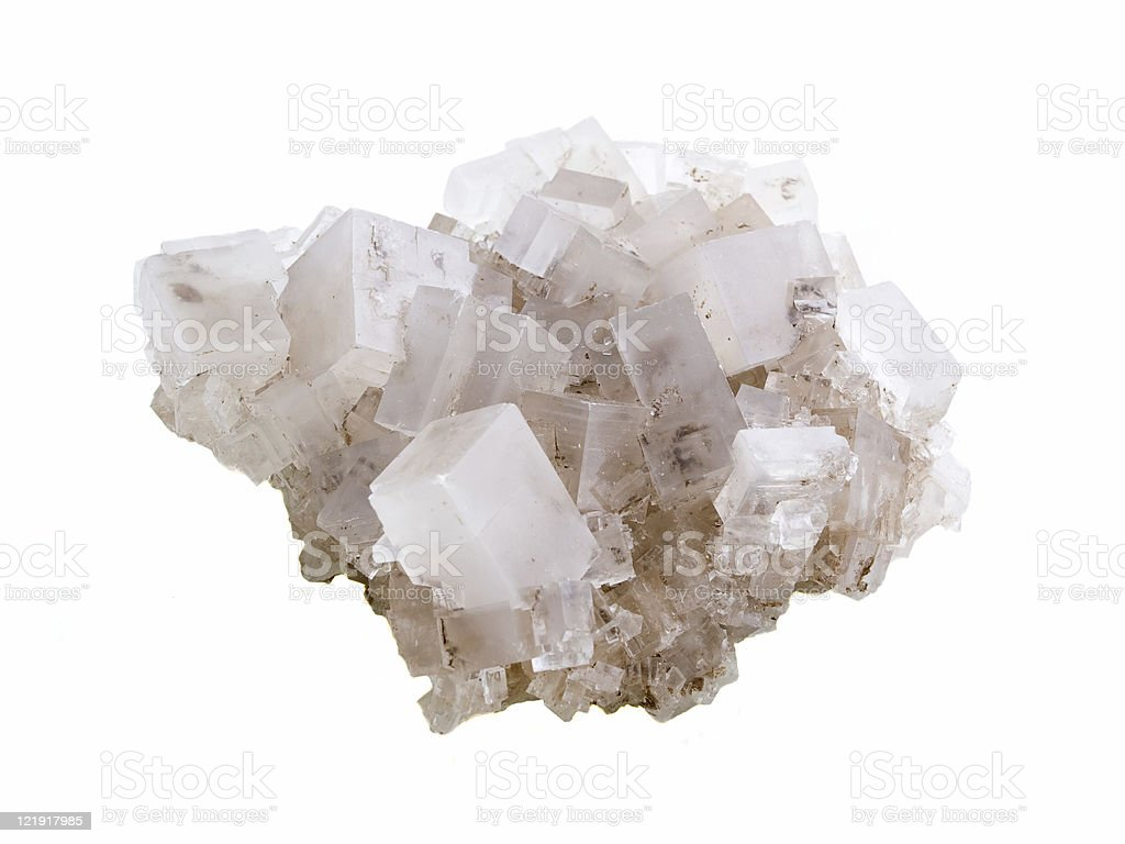 Close-up of rock salt against white background stock photo