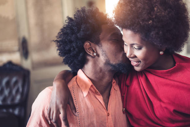 Close-up of romantic young couple looking at each other stock photo