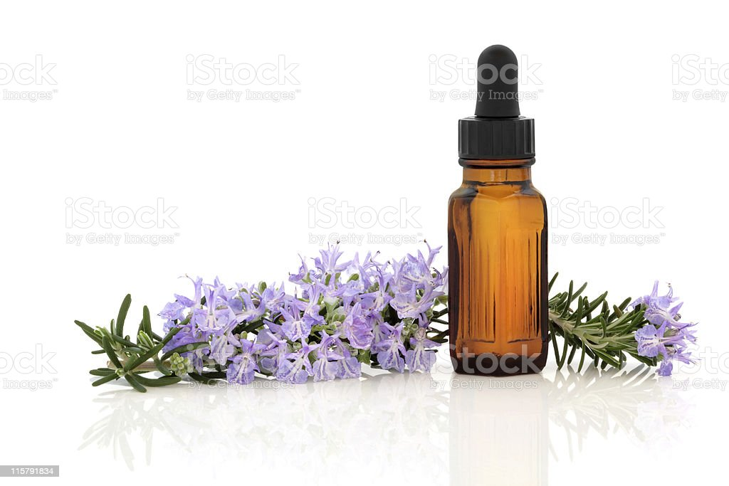 Close-up of rosemary herbal essence oil and white background stock photo
