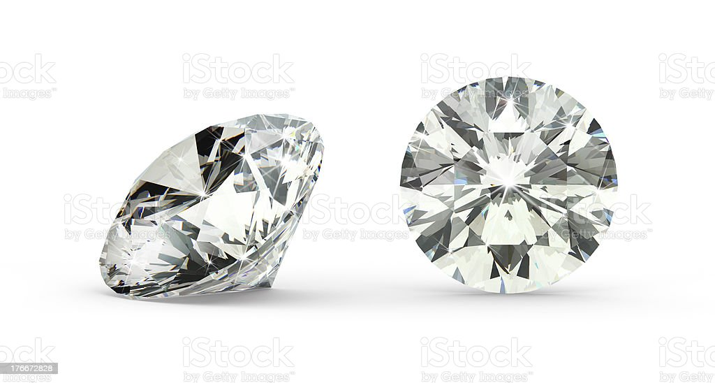 Close-up of round cut diamond on white background stock photo