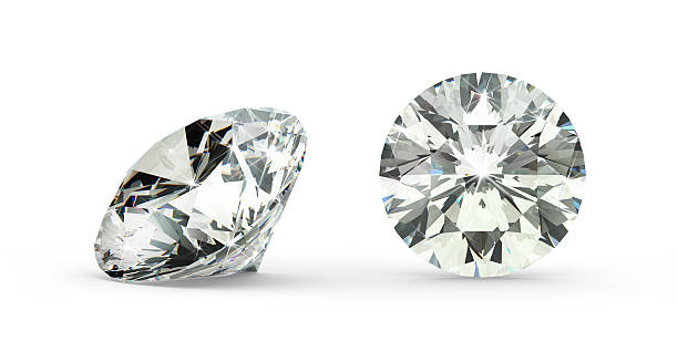 Close-up of round cut diamond on white background stock photo