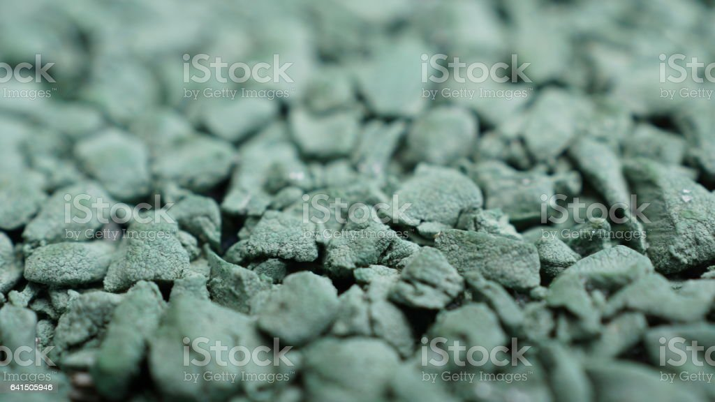 Close-up of rubber playground pellets. stock photo