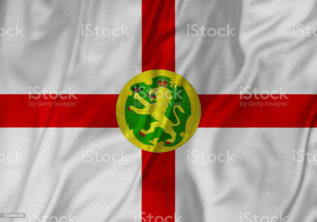 Closeup of Ruffled Alderney Flag, Alderney Flag Blowing in Wind stock photo