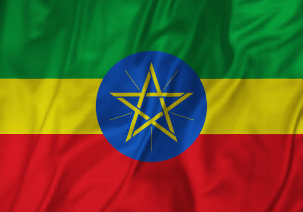 closeup of ruffled ethiopia flag, ethiopia flag blowing in wind - ethiopian flag stock photos and pictures