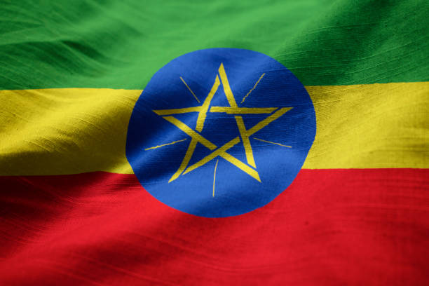 closeup of ruffled ethiopia flag - ethiopian flag stock photos and pictures