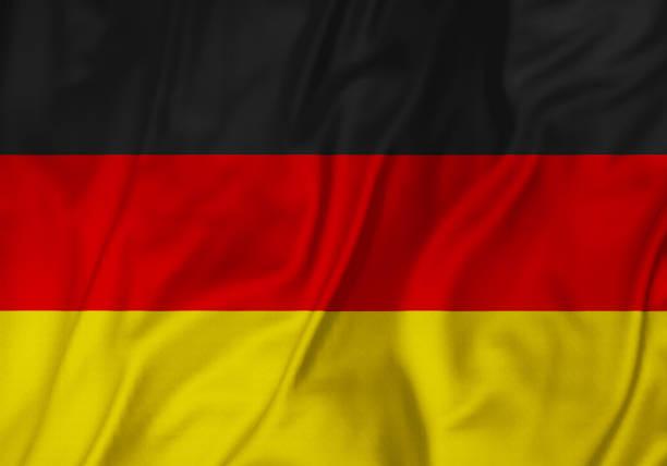 gros plan du drapeau de drapeau, allemagne allemagne ébouriffé dans vent - drapeau allemand photos et images de collection