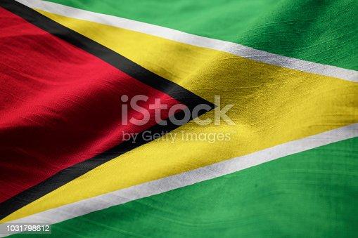 istock Closeup of Ruffled Guyana Flag 1031798612