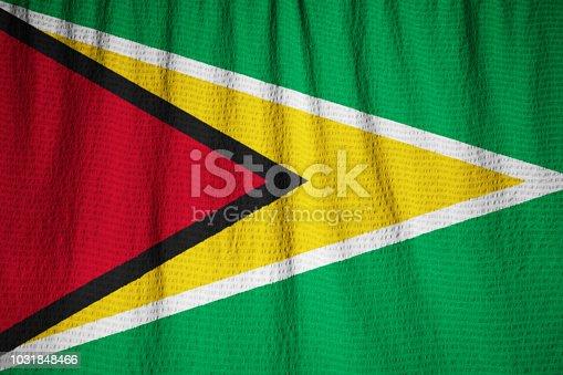 istock Closeup of Ruffled Guyana Flag 1031848466