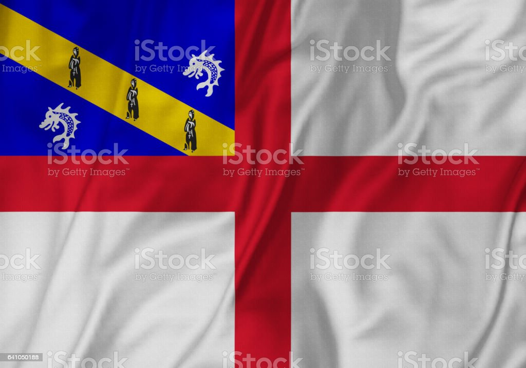 Closeup of Ruffled Herm Flag, Herm Flag Blowing in Wind stock photo