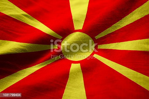 686175420 istock photo Closeup of Ruffled Macedonia Flag 1031799404