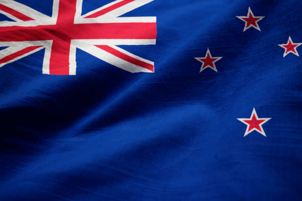 closeup of ruffled new zealand flag - new zealand flag stock photos and pictures