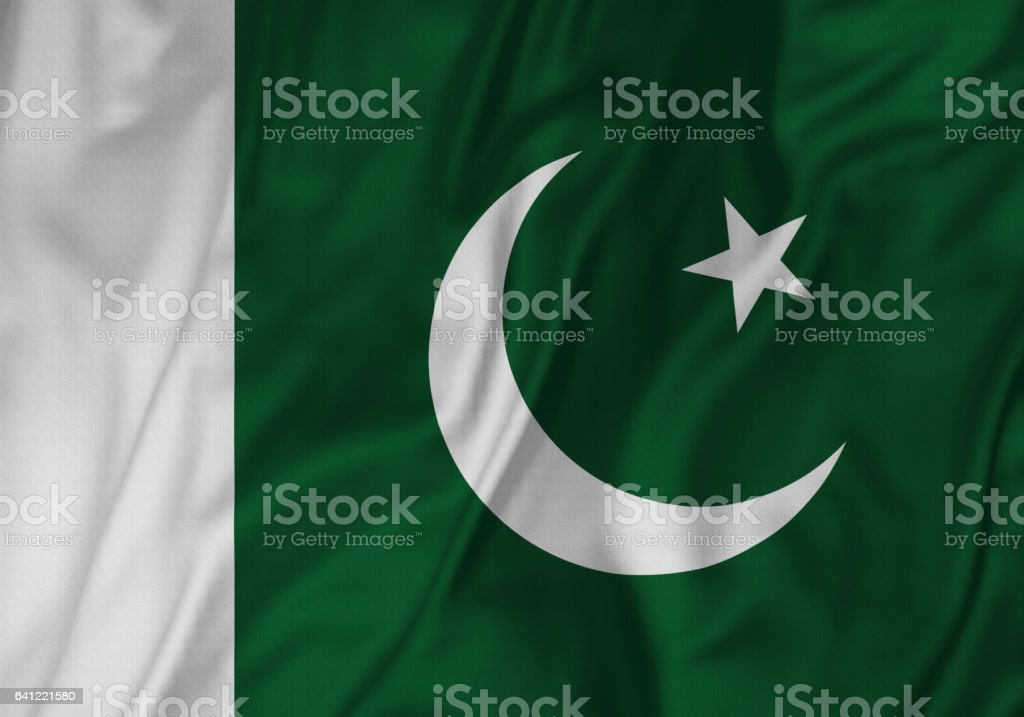 Closeup of Ruffled Paakistan Flag, Pakistan Flag Blowing in Wind stock photo