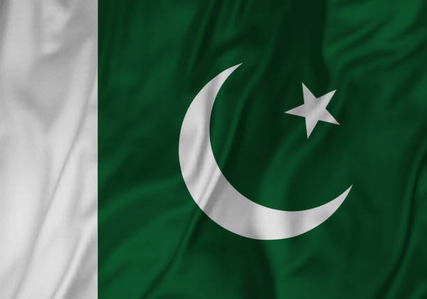 closeup of ruffled paakistan flag, pakistan flag blowing in wind - pakistani flag stock photos and pictures