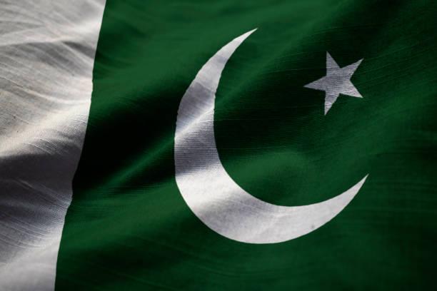 closeup of ruffled pakistan flag - pakistani flag stock photos and pictures