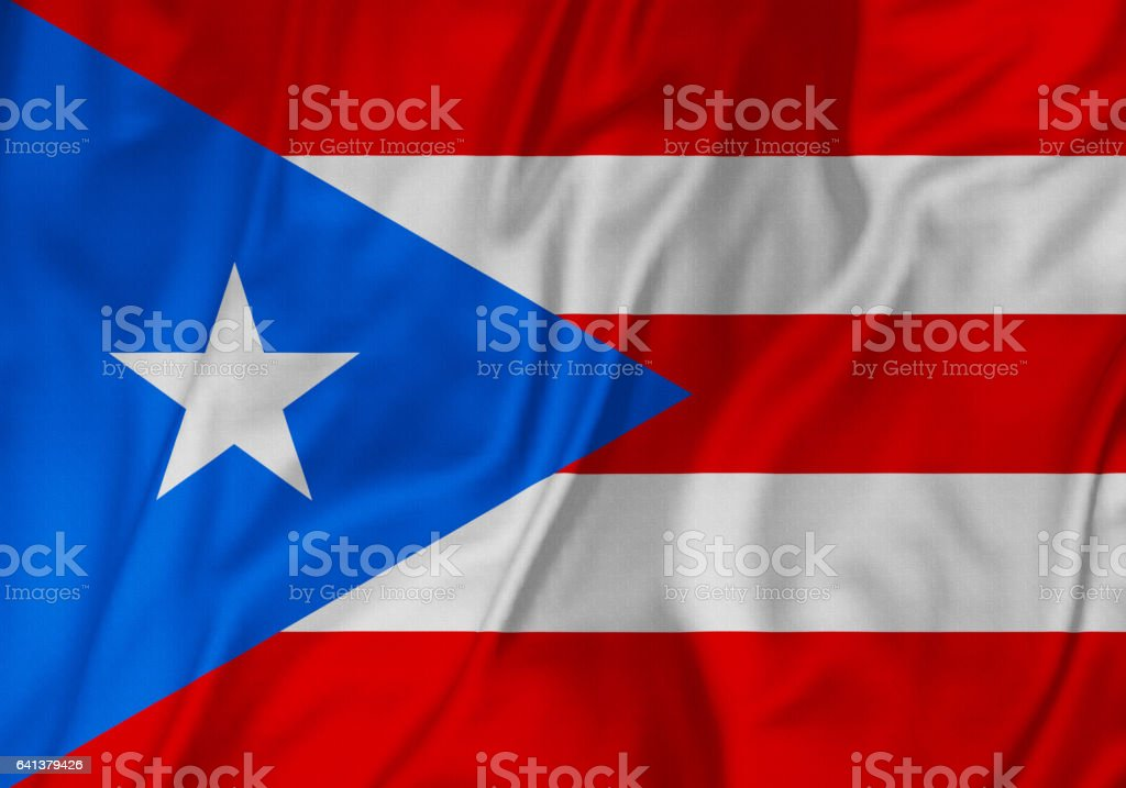 Closeup de volantes Puerto Rico bandera, la bandera de Puerto Rico que sopla en el viento - foto de stock