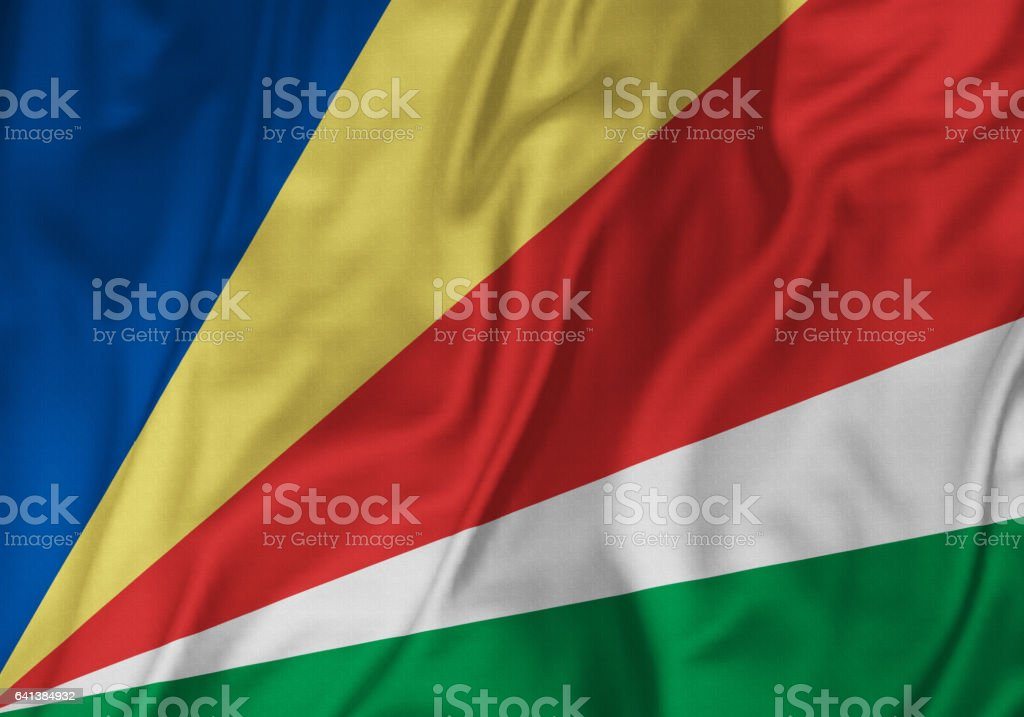 Closeup of Ruffled Seychelles Flag, Seychelles Flag Blowing in Wind stock photo