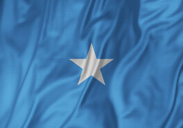 closeup of ruffled somalia flag, somalia flag blowing in wind - somalia stock photos and pictures