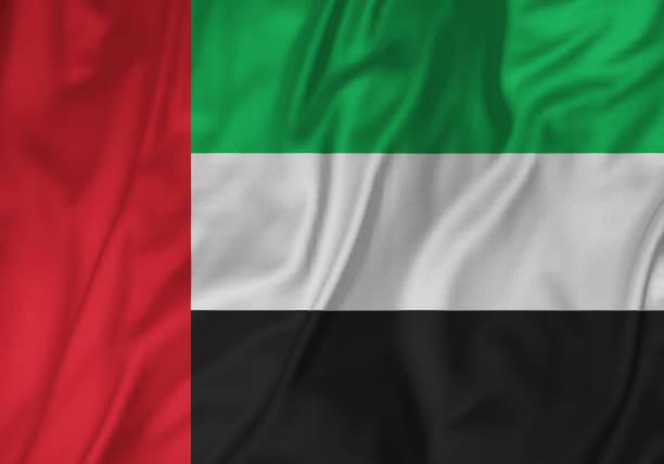 closeup of ruffled united arab emirates flag, united arab emirates flag blowing in wind - uae flag zdjęcia i obrazy z banku zdjęć