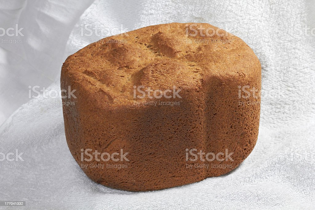 Closeup of rye wheat leavened bread on white tablecloth stock photo