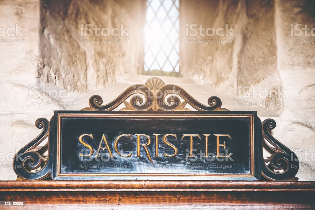 Close-up of Sacristy entrance sign text in french language in old architecture stoned church stock photo