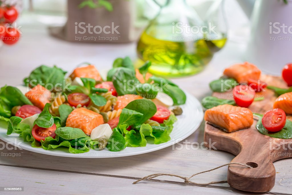 Closeup of salad with fresh vegetables and salmon stock photo