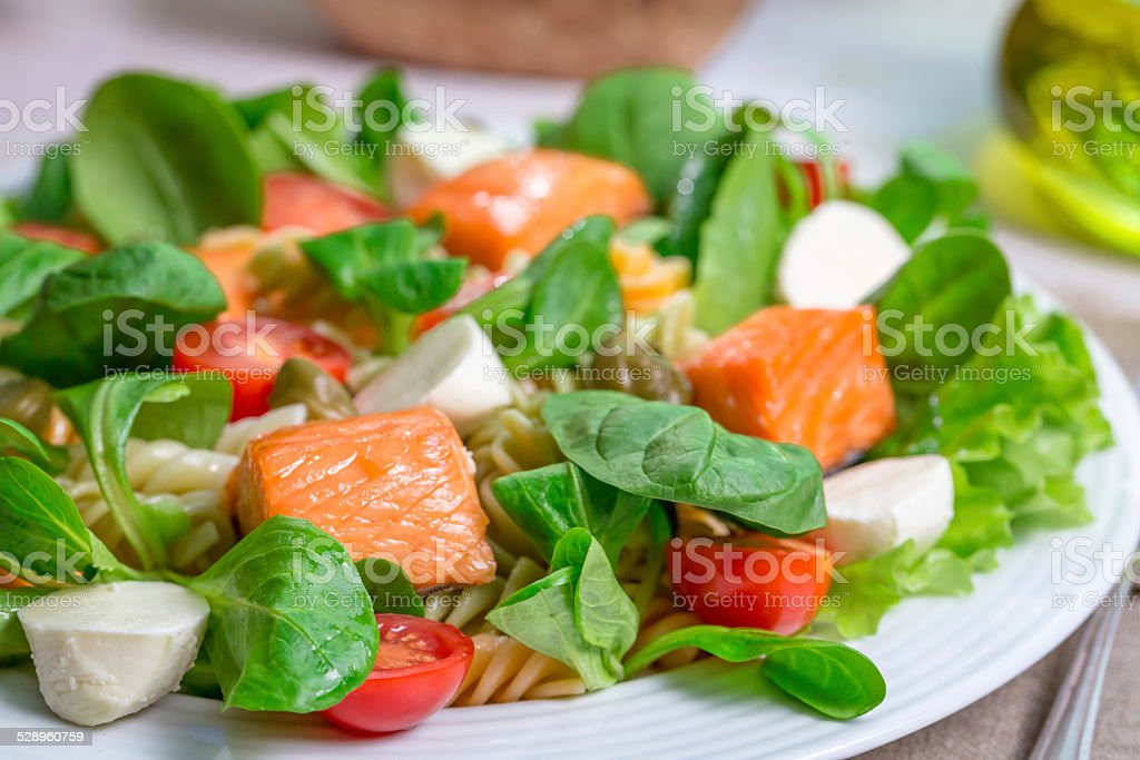 Closeup of salmon with vegetables and lettuce stock photo