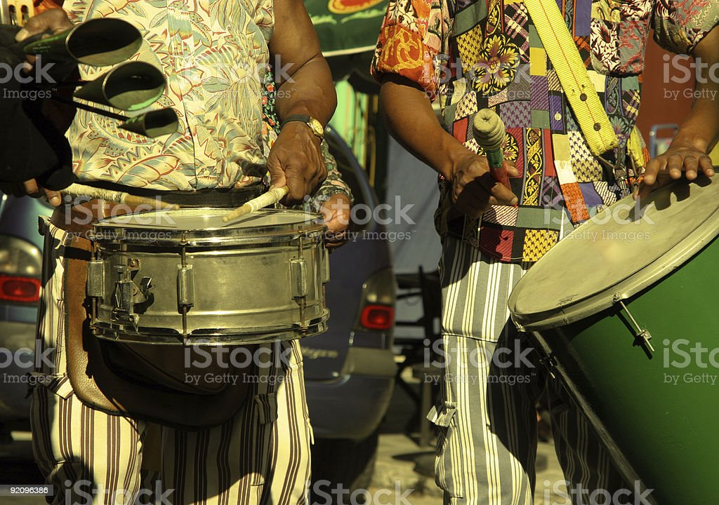 Close-up of samba musicians playing drums in sun stock photo